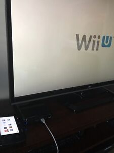 Wii U deluxe edition with 6 games and pro controller