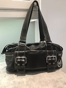Authentic Michael Kors black leather with many compartments .
