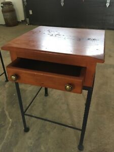 Two wood and metal side tables