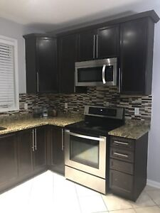 Set of full kitchen cabinets with granite countertop