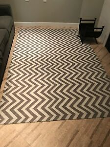 Grey and white chevron rug. Cotton weave. Approximately 5x7.