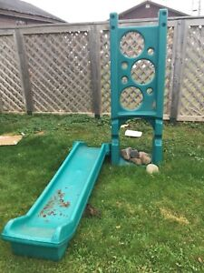 Rock wall and slide for a play house