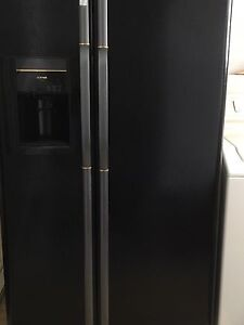 Side-by-side refrigerator with water and ice dispenser