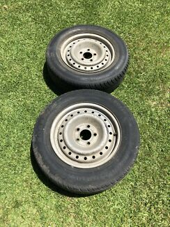 Ford 15inch steel rims with tires
