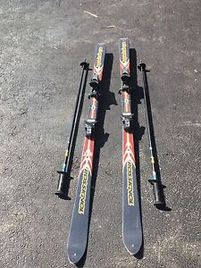 Two sets of skis and poles