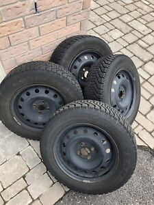 Almost new Goodyear Nordic Winter Tires P195/65R15 w/steel rims
