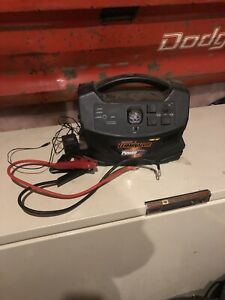 Booster pack with inverter and floor mats