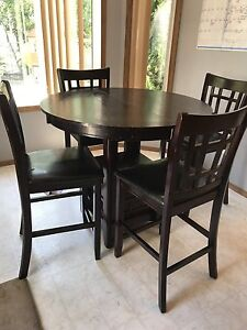 Bar height mahogany table and chairs