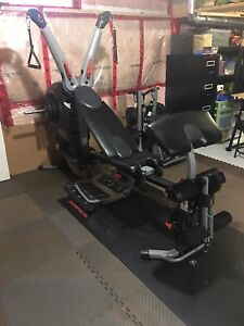 Bowflex Revolution home gym and accessory stand