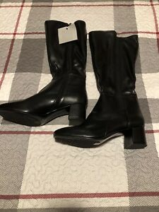 Naturalized black boot, leather