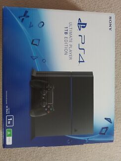 Black 1 TB Play Station 4 with 3 controllers and 9 games