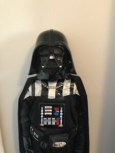 Darth Vader costume with retractable light sabre.