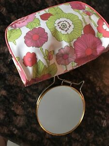 Dual sided magnification vanity mirror and makeup bag lot