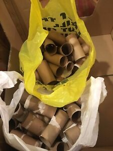 Two bags of toilet paper rolls