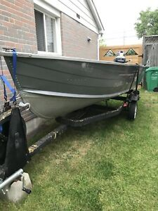 14 ft. Fisher Aluminum Boat with 25 hp. Evinrude motor