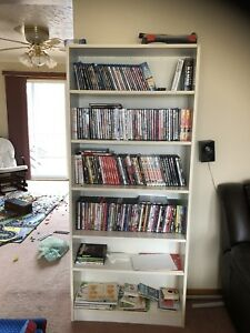 Tall white shelf ( DVDS not included )