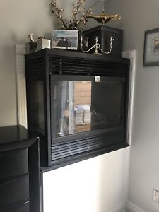 Three way gas fireplace in good condition