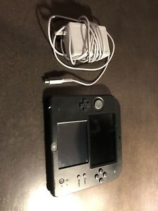 Nintendo 2ds with charger, games and amibo