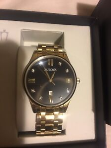 Bulova gold black face watch for sale