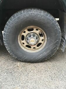315/75r16 Firestone Wildpeak tires on 8x6.5 Gm Rims