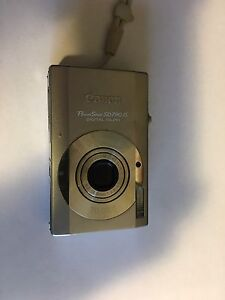 Canon PowerShot camera and accessories.