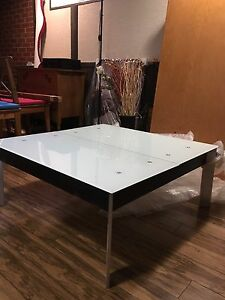 Glass coffee table with hidden storage