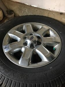 Studded winter tires and rims off of a 2014 ford f150