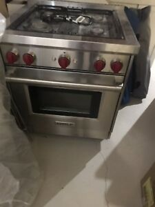 Wolf dual fuel gas stove with red burner knobs
