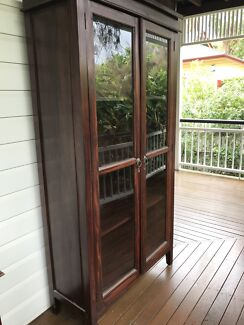 Timber cabinet with glass doors