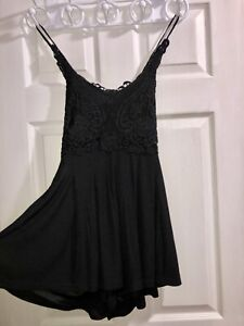 BRAND NEW without tags black romper from envy!
