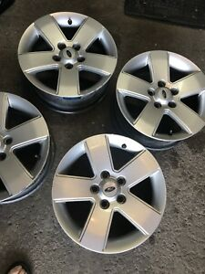 4 belles mags Ford 16' ( avec tpms) 5x 114.3