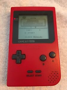 Red GameBoy pocket with Super Mario Land