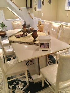 Large Italian dining table with 8 high quality chairs.