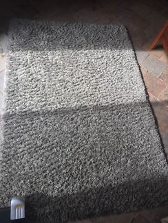 Large grey rug from a smoke free home
