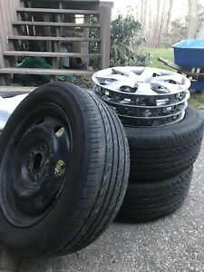 REDUDED 4 Mazda wheels, wheel covers all sEason tires 205/55R16