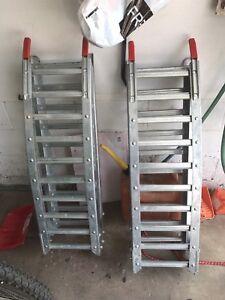3 steel folding ramps 6 ft long.