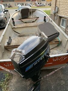 12 feet fishing boat with Mercury 100 engie