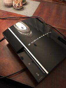 PS3 40Go (thick) + 12 jeux
