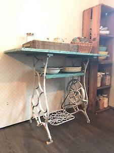 Accent table with tredle sewing machine base