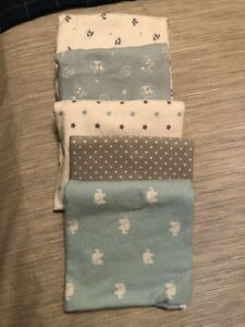 Set of 5 large sized, flannel receiving blankets.