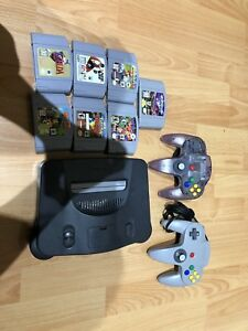 N64 2 controllers and 7 games