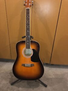 $200 acoustic guitar with accessories