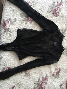 Long sleeve black sheer body suit from Envy