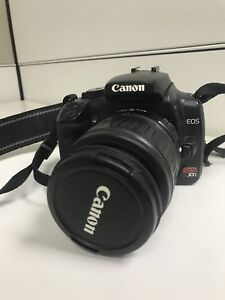 Camera- canon rebel xti- with lens'