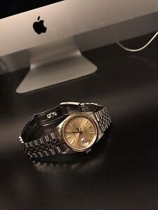 Rolex DATEJUST Stainless Gold Dial and Face.