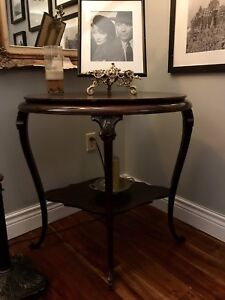 Hand carved double faced antique walnut table