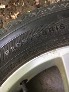 16 Inch Mazda Alloy Rims with good rubber.
