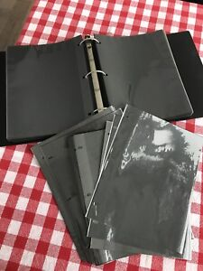 Various binders with photo sheet inserts