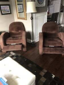 Two. Brown reclining chairs