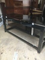 Tv stand with glass in very good condition for $80
